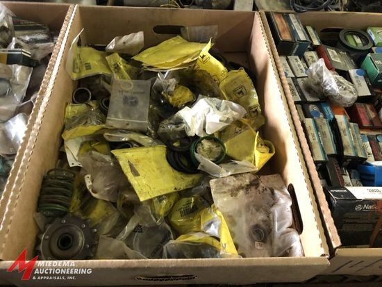 BOX OF ASSORTED SMALL JOHN DEERE PARTS, INCLUDES ASSORTED BEARINGS, SPRINGS, SEALS, SPROCKETS, AND M