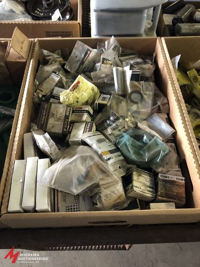 BOX OF ASSORTED CASE BRAND BEARINGS, SEALS, CAPS, AND MISCELLANEOUS OTHER PARTS, MOST APPEAR TO BE N