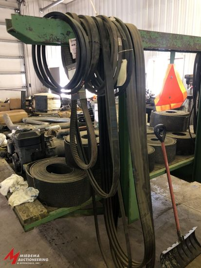 ASSORTED NEW AND USED COMBINE BELTS, INCLUDES VARIOUS SIZES AND STYLES.