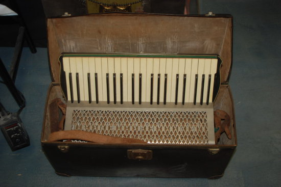 Accordion in leather case