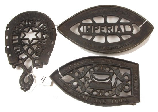 (3) Sad Iron Trivets: Good Luck; U Need It; Imperial
