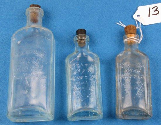 """3-glass Oil Bottles; Ecs Kk Logo; 5""""; 4""""aqua; 4""""clear"""