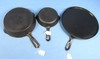 3 Items: (all Have Dmg.). #4 Skillet (hairline); Griswold Slant Erie; Pn 702; Hr; #8 Wapak Indian (