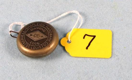 Norvell Shapleigh Tape Measure; Very Unique Sm. Metal Diamond Edge Pc. 1 3/8in Dia.