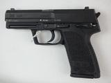 HK USP PISTOL 9MM SN:   24-11135 W/ MAG, GOOD