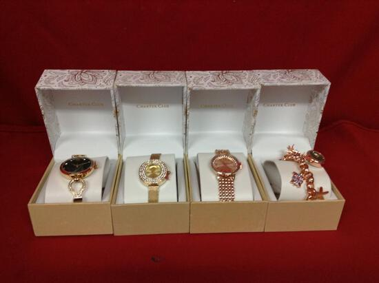 (4 qty) Watches in boxes (with clear stones) (gold in color) (unauthenticated)
