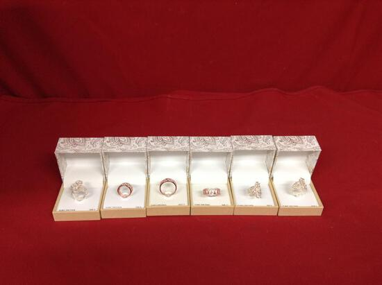 (6 qty) Designer rings with clear stones (costume) in ring boxes (unauthenticated)