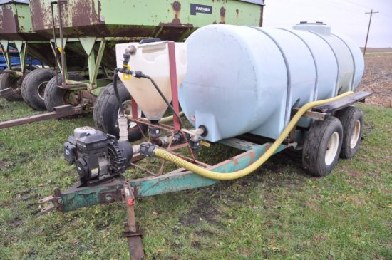 1,000 gal. poly tank on tandem axle trailer