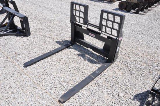 Stout walk-through pallet forks for skid loader