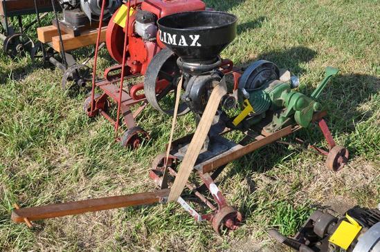 Maytag single-cylinder engine w/ Climax grinder mounted on steel wheel truck