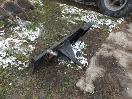 Skidsteer plate with hitch and ball hitch.