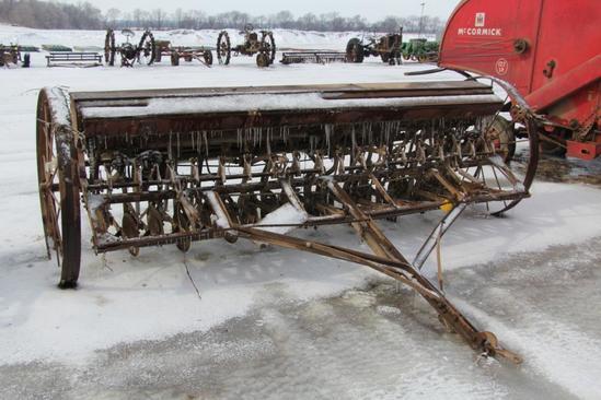 McCormick-Deering 11' grain drill on steel