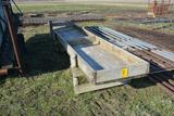 2 wooden cattle feed bunks