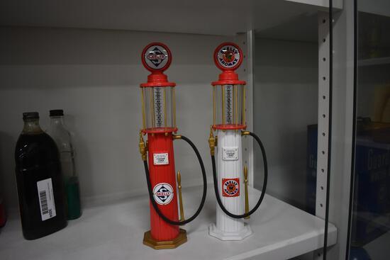 (2) Skelly gas pump banks