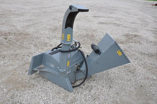 Edge woodchipper attachment for skid steer