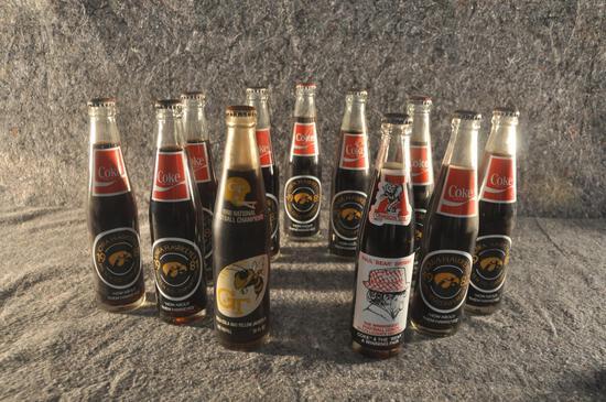 11 unopened bottles Coca-Cola with Iowa Hawkeye advertisement