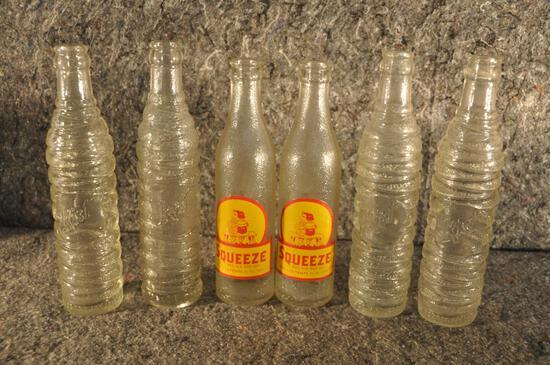 (6) soda bottles