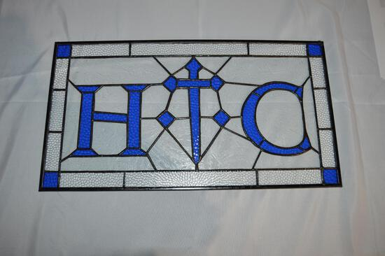 Stained HTC glass sign - blue glass from high school chapel