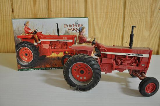 collectible international 826 tractor with figurine