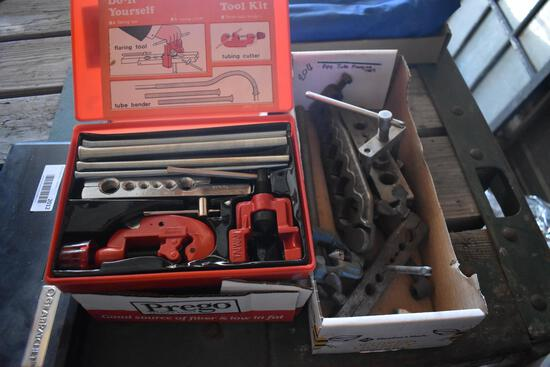 2 flats of tools including a tube cutter, flaring tool, tube bender, and flanging tools