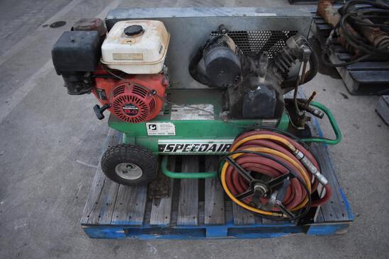 Speedaire portable air compressor, Honda GX240 eng., hose reel