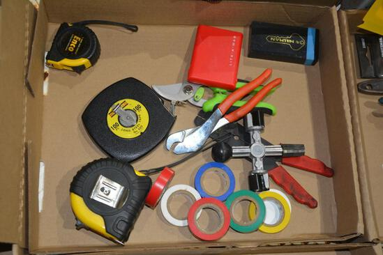 Flat of tape measures and electrical tape