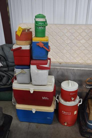 Stack of water coolers and jugs