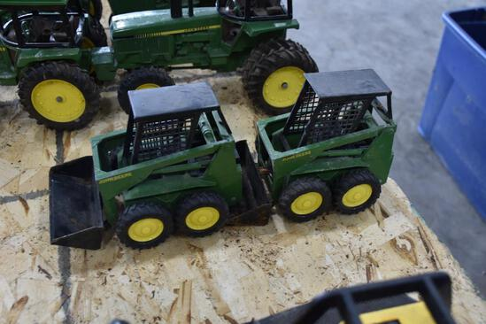 2 John Deere skid loader toys