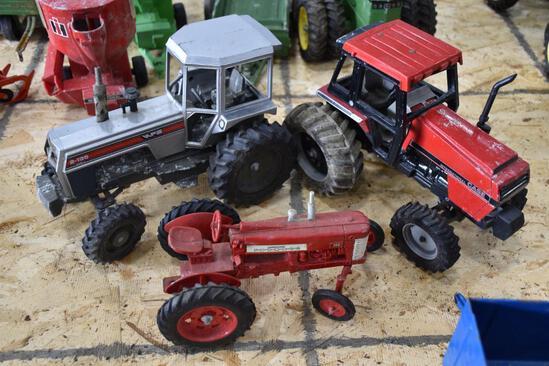3 Tractors to include, Case, Farmall, and White