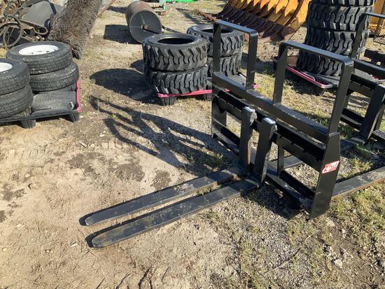 Unused 48in 4200lbs Step Thru Pallet Fork Attachment