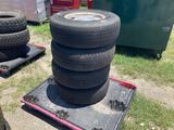 Four 235/75R15 Tires