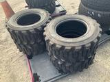 Four Unused 12-16.5 Tires