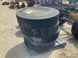 Four used 11R22.5 tires w/ wheels
