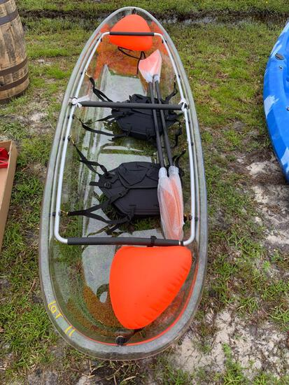 Two person, see through canoe w/ paddles