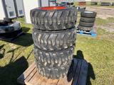 4 Unused Skid Steer Tires With Wheels