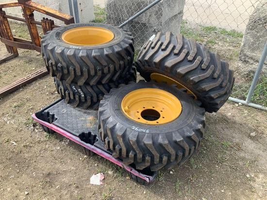 Four Unused 12-16.5 Skidsteer Tires with Rims