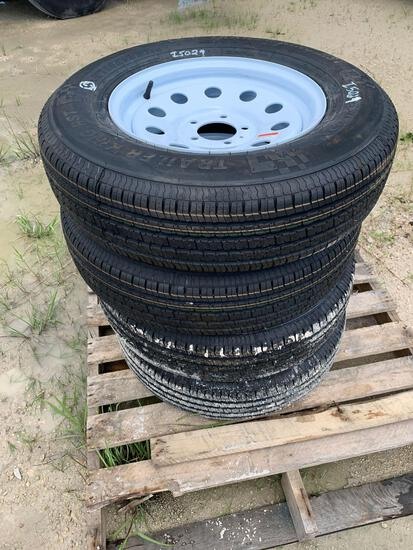 Four 205/75R15 Unused Trailer Tires and Wheels