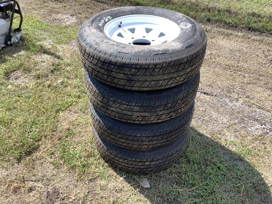 Four Unused ST225/75R15 Trailer Tires and Wheels