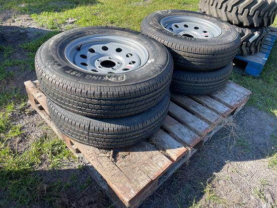 Four Unused 205/75R15 Trailer Tires and Wheels