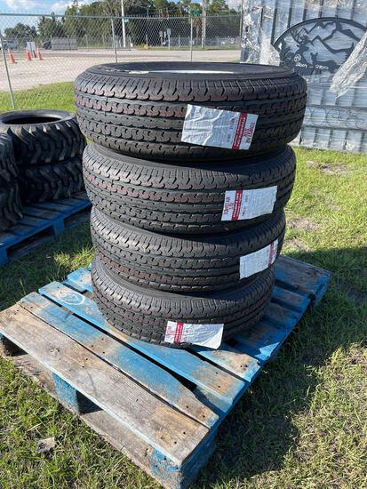 Four Unused ST235/80R16 Trailer Tires and Wheels