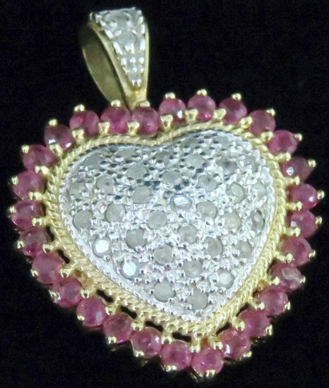 Pendant marked 10K with red & clear stones. Approx 3.1 grams.