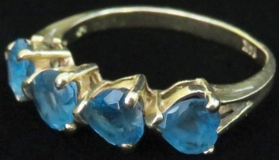 Ring marked 14K with blue stones. Approx 2.8 grams.