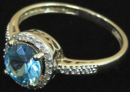 Ring tests 14K with blue & clear stones. Approx 2.6 grams.