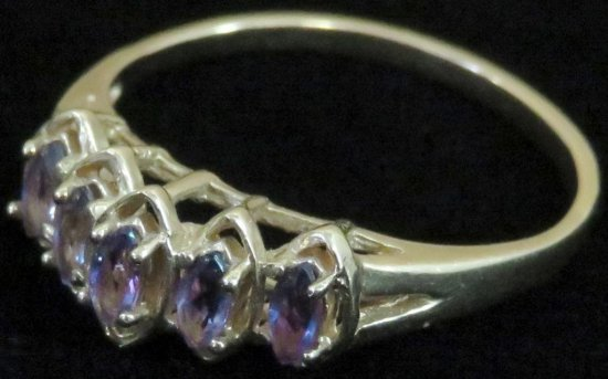 Ring tests 14K with purple stones. Approx 2.2 grams.