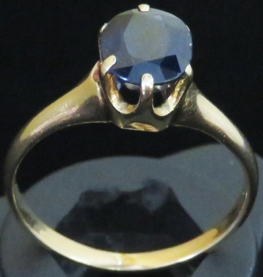 Ring tests 14K with blue stone. Approx 3.1 grams.