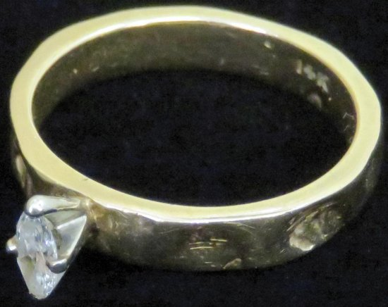Ring marked 14K with clear stone. Approx 4.2 grams.