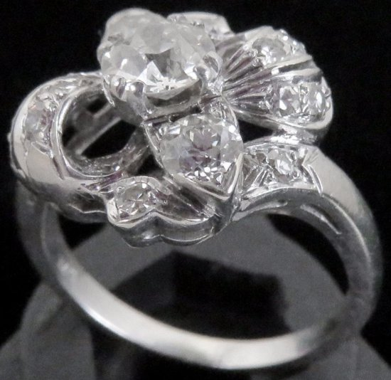 Lady's 14K white gold Ring with (17) diamonds.