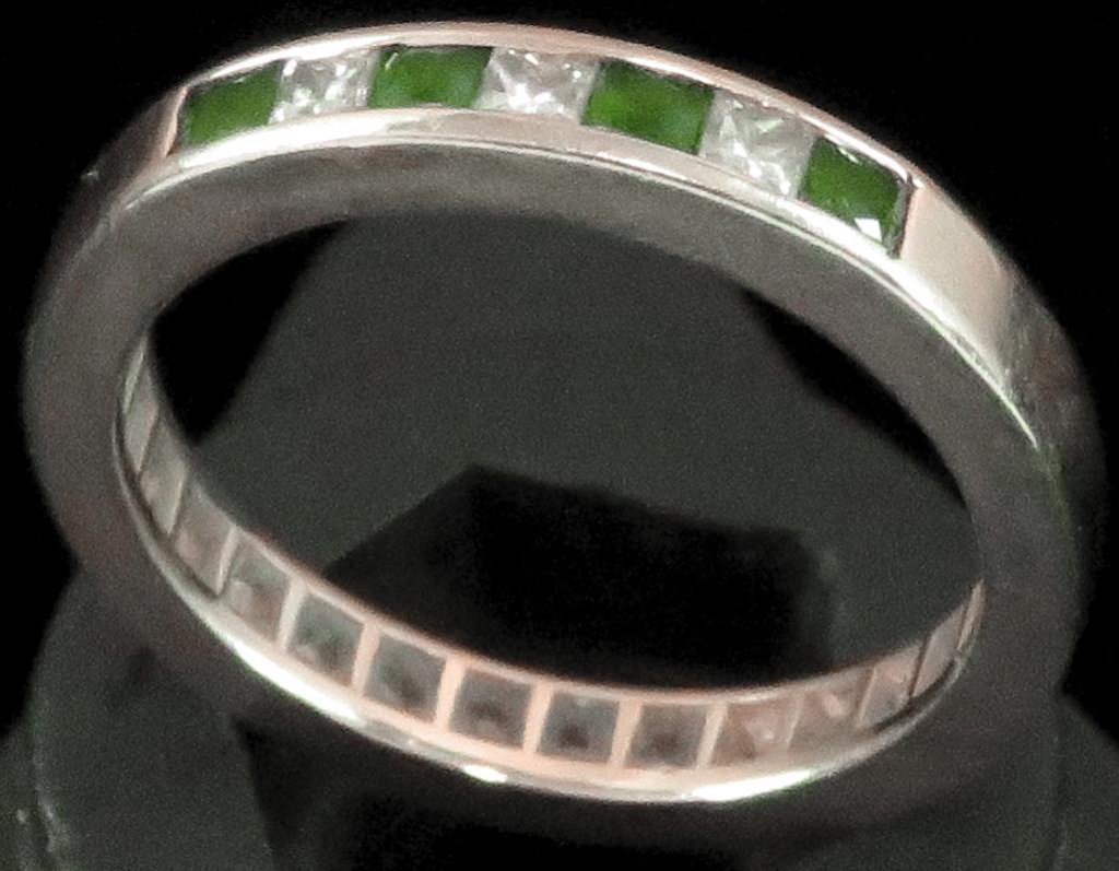 Ring tests 14K with green & clear stones. Approx 4.2 grams.
