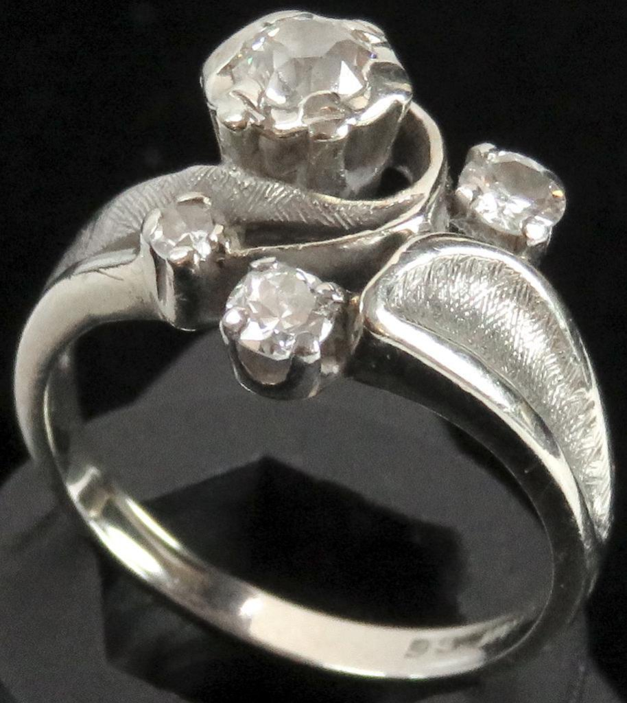 Ring marked 14K with (4) diamonds. Approx 4.1 grams.
