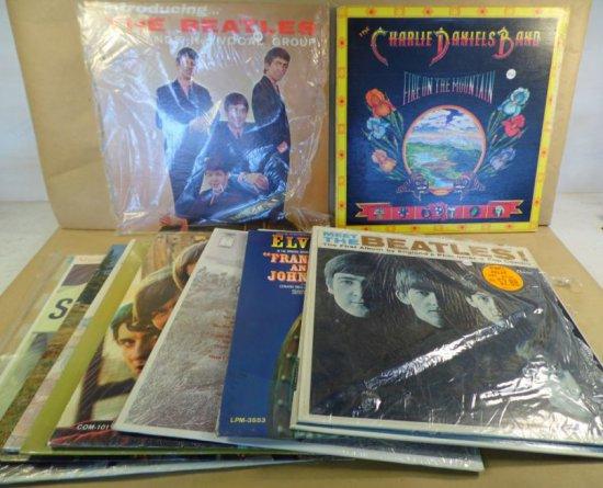 Lot of thirteen vintage albums.  Includes Elvis, Beatles, Monkees, Charlie Daniels Band, Kookie Edd